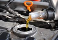 Changing oil on a customers vehicle here at the shop (Neigborhood Mechanic) located in Big Lake Minnesota.